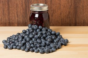 Fresh blueberries and jar