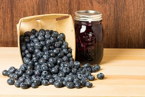 Box of blueberries and jar