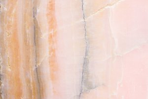 Lightened slices marble onyx. Horizontal image. Warm pink colors. Beautiful close up background