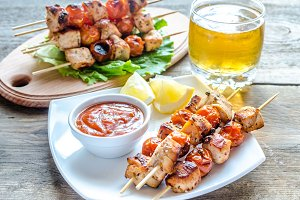 Grilled chicken skewers with cherry