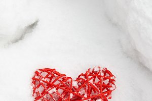 Red valentine heart in snow