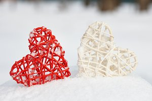 Red and white valentine hearts in snow