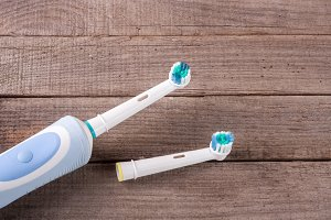 Electric Toothbrush on an old wooden background