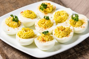 Filled deviled eggs on plate
