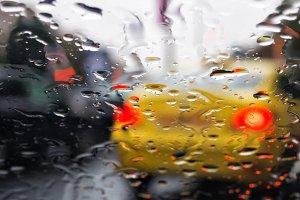 Rain on windshield of car seen from inside car