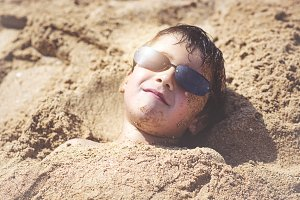 Boy with sunglasses on the beach