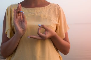hand of a woman meditating