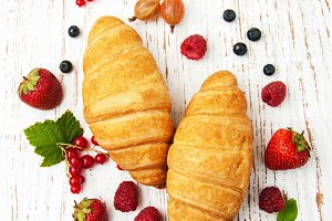 Fresh berries and croissants