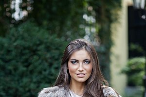 Young beautiful woman in fur coat