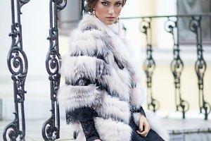 Girl posing in a fur waistcoat