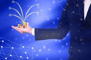 Businessman hold golden money