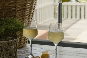 Two glasses of white wine with cheese, rustic, selective focus