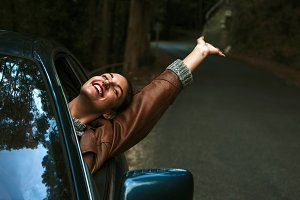 enjoying girl in the car on the road