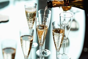 Champagne pours into the wineglasses