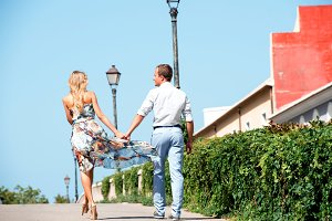 Couple walking in the city of Denia, Spain on summer day
