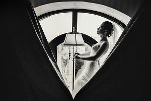 Bride holds a vintage lamp