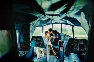 Groom kisses a bride in a helicopter