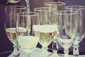 Champagne flows into the wineglasses