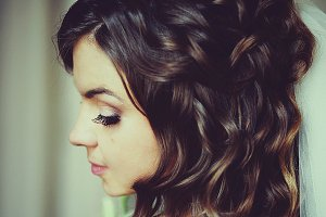Pretty bride with brown curly hair