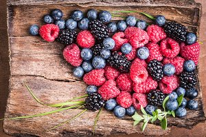 Fresh berries on wood background.