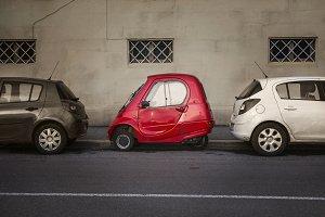funny Italian retro car on a city street