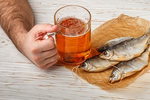 glass of beer and dry fish