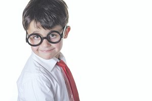 Boy with glasses and tie