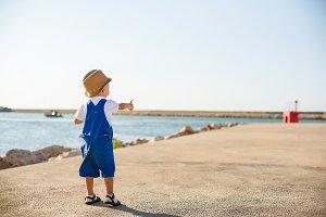 Portrait of a cute blond boy in hat
