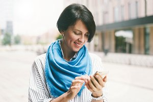 Brunette woman using smartphone