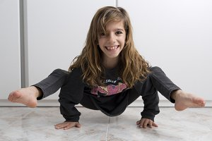 Girl doing gymnastics next
