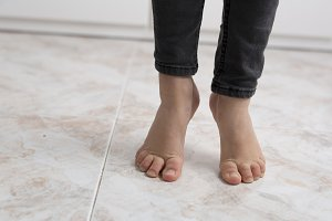 Feet of a barefoot girl