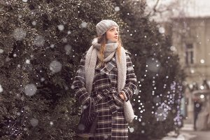 young woman snowing snow walking