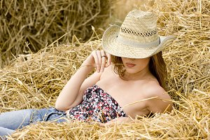 cowgirl relaxing in the straw