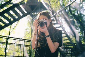 Young hipster girl taking photo