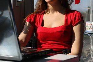 Woman in red shirt