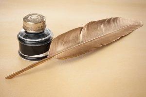 Golden quill pen on parchment