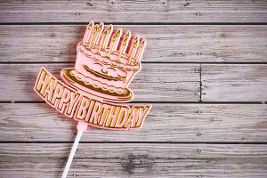 happy birthday on wooden background