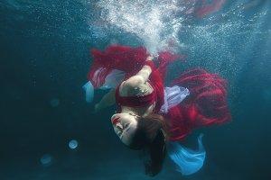 Underwater dancing girl.