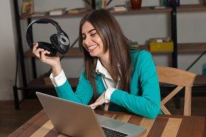 woman with  black headphones