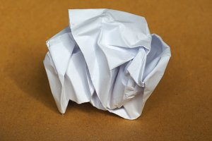 crumpled paper over brown background with copy space