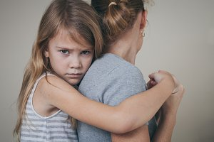 sad little girl and mother