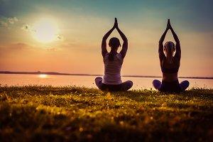 Yoga workout a couple sunset