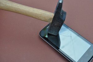 Hammer hitting a cell phone
