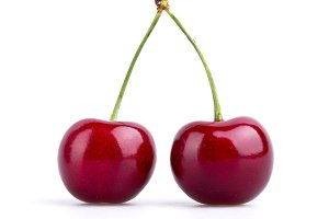 Two perfect ripe cherries isolated