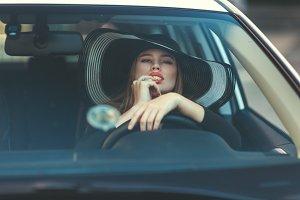 Woman sexually touching lips.