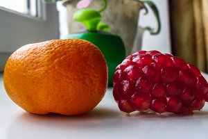 Mandarin and pomegranate close up