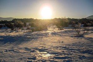 Sun shining on winter field