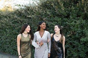 Girls Walking in Sequin Dresses
