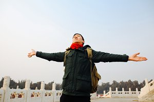 Asian man stretching arms wide open