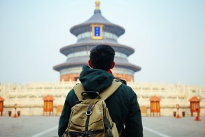 Young traveler standing in front of temple of heaven - in Beijing, China. Asia Travel